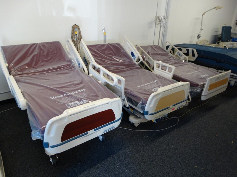 Stryker Secure 2 hospital bed with round rails (far left) with Stryker secure 2 square rail bed in the middle. Order beds call 858-731-7278