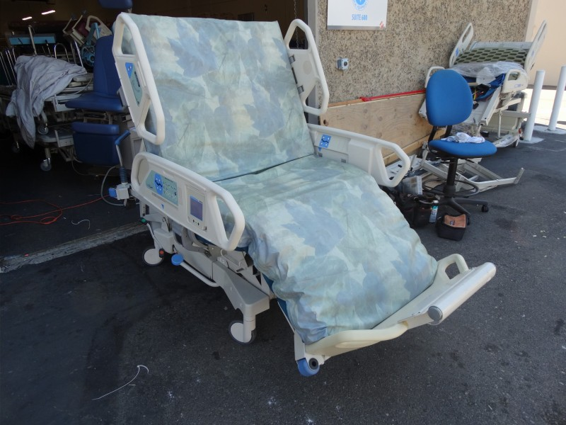 TotalCare Bariatric Hospital Bed in chair position - the foot piece comes off and the bed goes lower to help patient get in and out of bed.